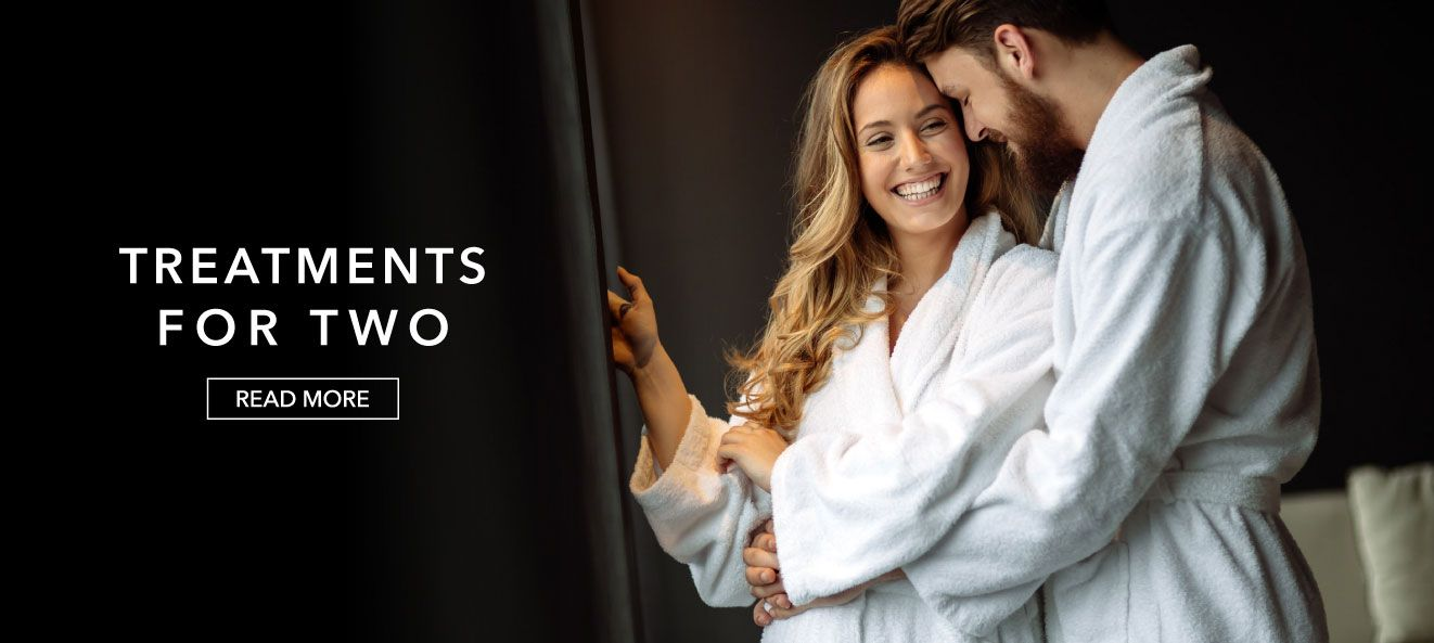 couple enjoying their spa treatment with treatment for two overlaid text