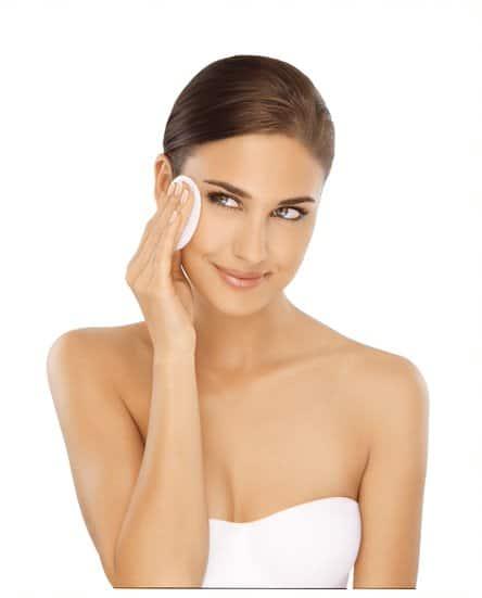Female using a cream face applicator